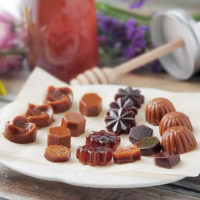 array of caramel-colored honey candies on a plate