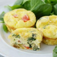 three mini egg muffins with veggies