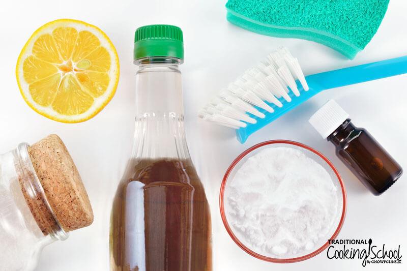 array of natural cleaning ingredients, includnig half a lemon, baking soda, and apple cider vinegar