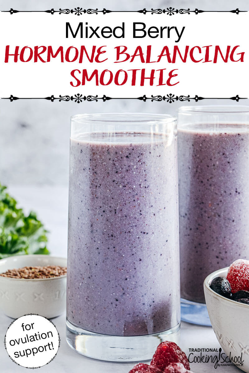 """two tall glasses of purple smoothie with text overlay: """"Mixed Berry Hormone Balancing Smoothie (for ovulation support!)"""""""