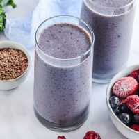 glasses of purple smoothie for ovulation support and hormone balance