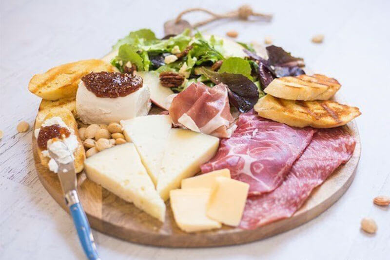 salad and charcuterie board