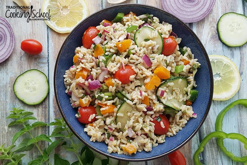 cold brown rice salad in a bowl with garden veggies