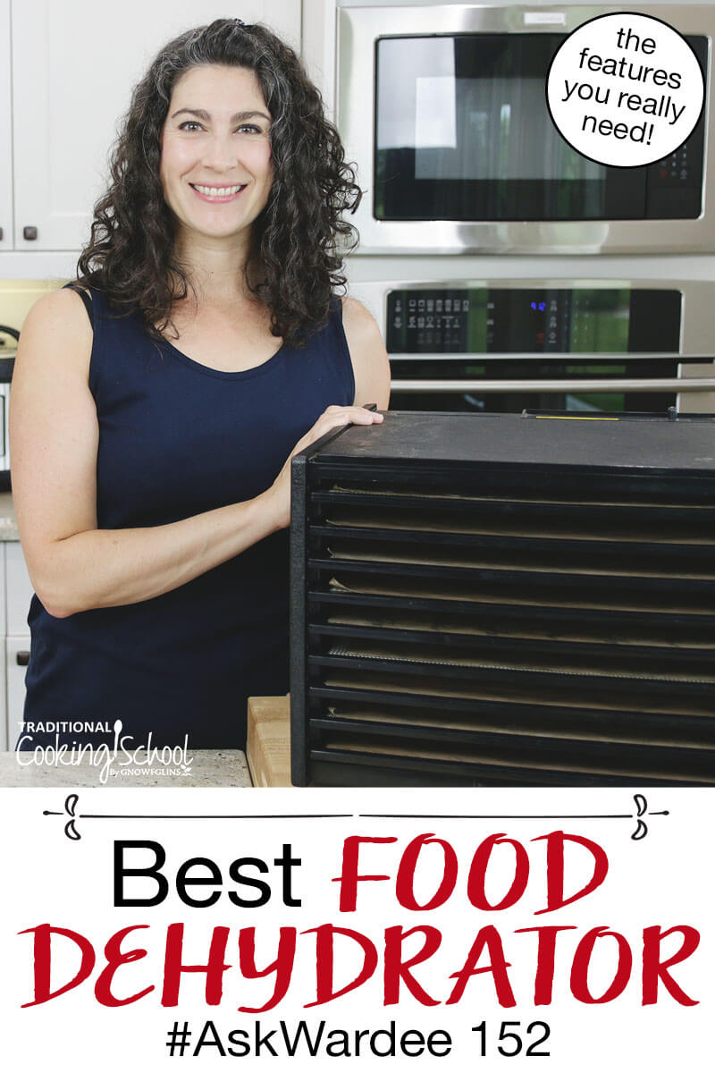 "woman smiling in a kitchen next to a 9 tray vertical food dehydrator. Text overlay: ""Best Food Dehydrator #AskWardee 152 (the features you really need!)"""