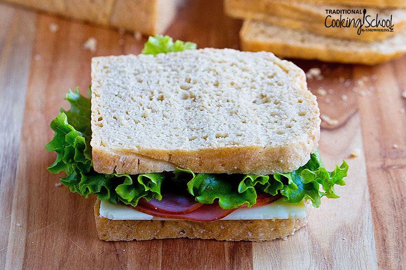 A sandwich sitting on a cutting board.