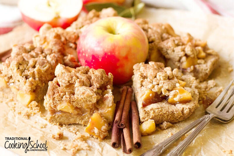 apple pie shortbread bars arranged around an apple in the center