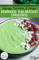 """bright green smoothie bowl garnished with coconut, freeze-dried raspberries, and chia seeds. Text overlay says: """"Mango, Turmeric & Ginger Hormone Balancing Smoothie (for period support!)"""""""