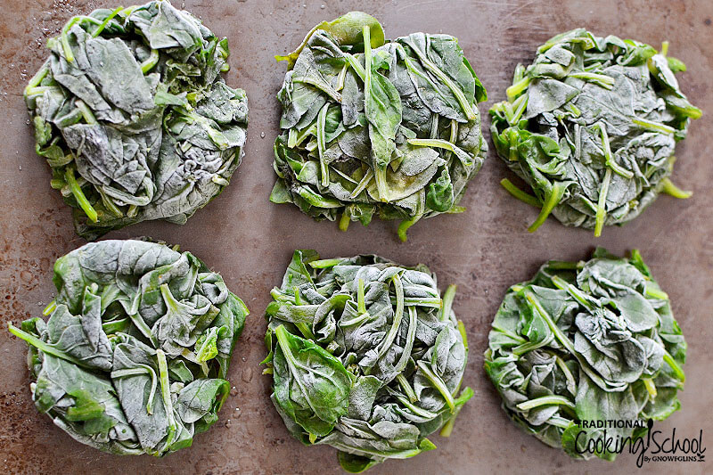 """frozen, pre-steamed spinach """"pucks"""" on parchment paper"""