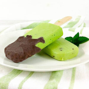 two popsicles, one dipped in chocolate, on a plate