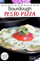 "cheesy, herbed pizza on a plate. Text overlay says: ""Sourdough Pesto Pizza (sourdough discard recipe!)"""