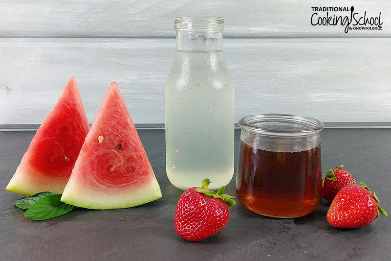 ingredients needed to make a fruit sorbet, including watermelon, strawberries, water kefir, and more