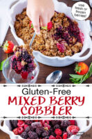 "Scooping into a cobbler garnished with fresh strawberries, in a white casserole dish with scalloped edges. Text overlay says: ""Gluten-Free Mixed Berry Cobbler (use fresh or frozen berries!)"""