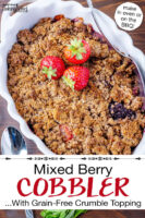 """Cobbler garnished with fresh strawberries, in a white casserole dish with scalloped edges. Text overlay says: """"Mixed Berry Cobbler ...With Grain-Free Crumble Topping (make in oven or on the BBQ!)"""""""