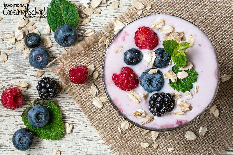 Kefir topped with fresh berries and oats.