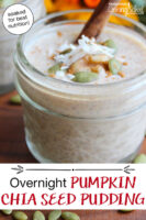 "1/2 pint jar of chia seed pudding, topped with a cinnamon stick, sprinkle of cinnamon, shredded coconut, and pumpkin seeds. Text overlay says: ""Overnight Pumpkin Chia Seed Pudding (soaked for best nutrition!)"""