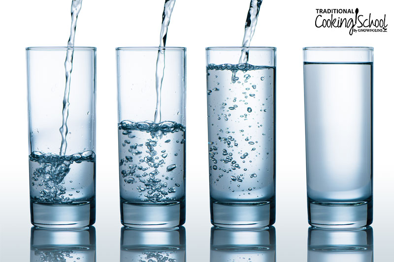Four glasses in a row with varying amounts of water being poured into them.