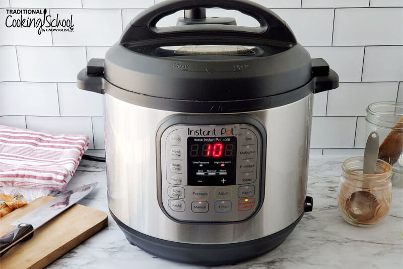 The Instant Pot, cooking on high pressure with 10 minutes of time left.