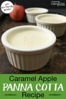 "Panna cotta in small ceramic bowls on a tray with an apple in the background. Text overlay says: ""Caramel Apple Panna Cotta Recipe (with gut-friendly gelatin!)"""