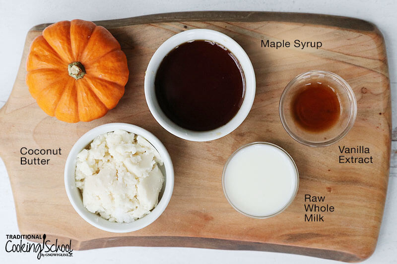Overhead shot of ingredients for vanilla icing, including coconut butter, maple syrup, vanilla extract, and raw whole milk.