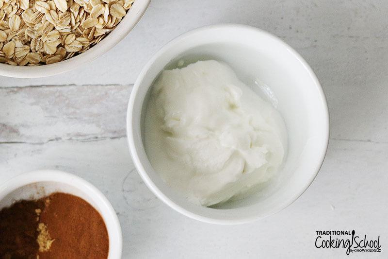Small white ceramic bowl of yogurt.