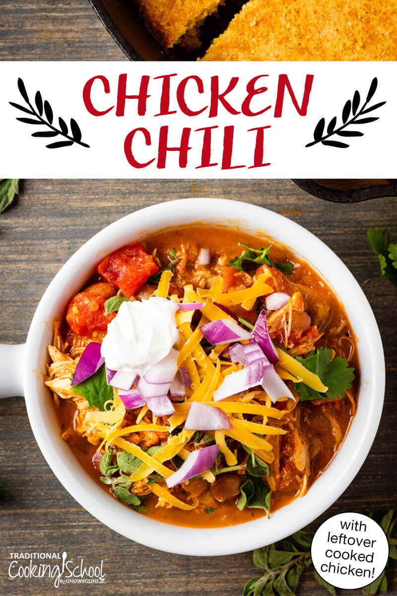 Pinterest pin with an image of a bowl of chili topped with sour cream, cheddar cheese, cilantro and onions.