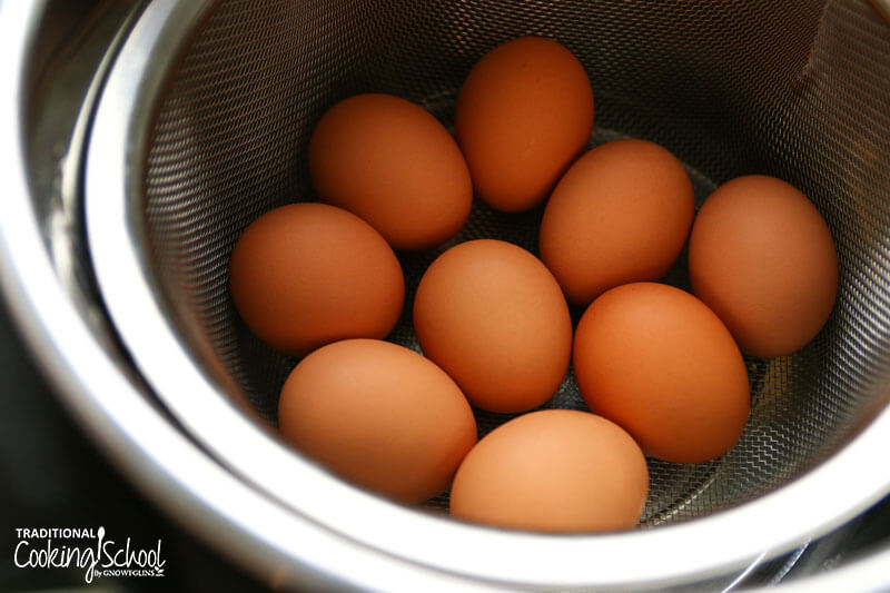 Whole eggs placed in a steamer basket about to be hard-boiled in the Instant Pot.