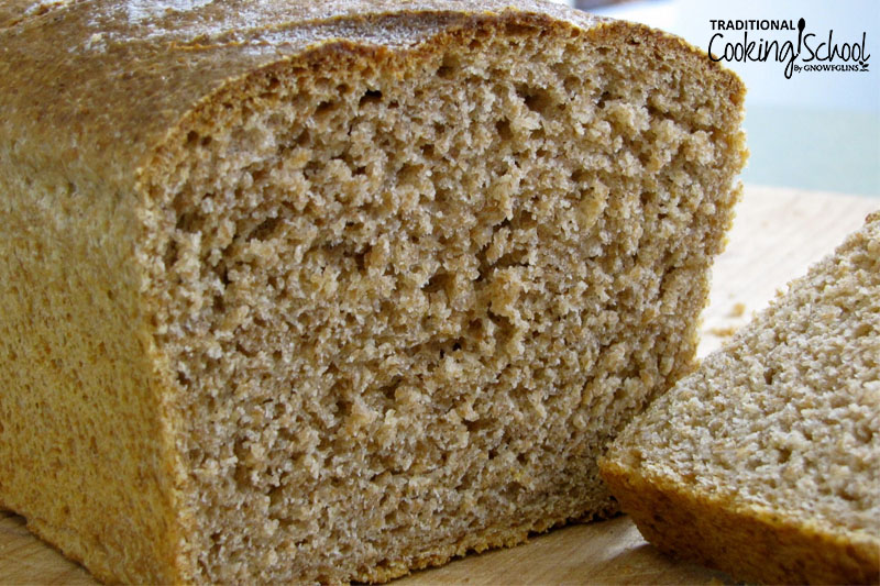 Close-up shot of a fluffy, whole grain loaf of sourdough bread sliced open to reveal the inner texture.