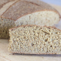 Slice of whole grain sourdough bread.