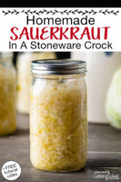 "Sauerkraut in a glass jar. Text overlay says: ""Homemade Sauerkraut In A Stoneware Crock (+FREE tutorial video!)"""