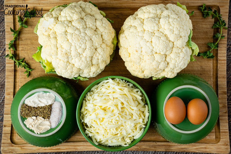 Ingredients for making cauliflower pizza: Cauliflower, spices, grated cheese, and eggs.