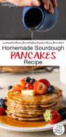 "Stack of sourdough pancakes on a plate topped with fresh fruit, butter, and being drizzled with syrup. Text overlay says: ""Homemade Sourdough Pancakes Recipe (make in the skillet or griddle!)"""