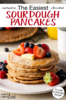 "Stack of sourdough pancakes on a plate topped with fresh fruit and butter. Text overlay says: ""The Easiest Sourdough Pancakes (no wait sourdough recipe!)"""