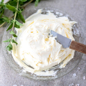 Cultured cream cheese on a small serving plate.