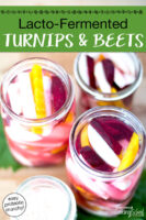 """Overhead shot of turnips, beets, and golden beets in quart- and pint-sized glass jars filled with brine, ready to be fermented. Text overlay says: """"Lacto-Fermented Turnips & Beets (easy probiotic crunchy!)"""""""