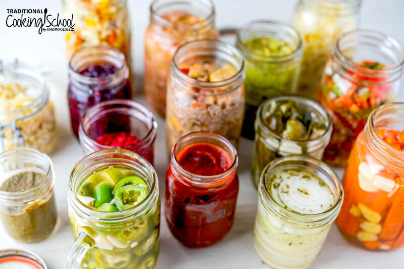 Wide variety of colorful ferments in glass jars.